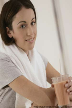 A woman holding whey protein shake