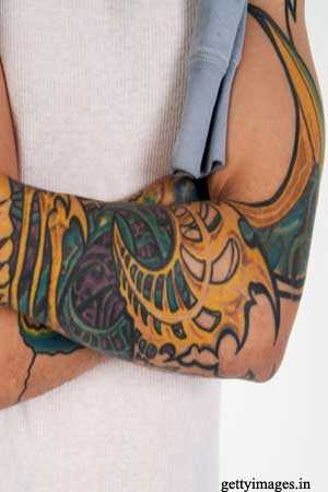 Man with tattooed arms
