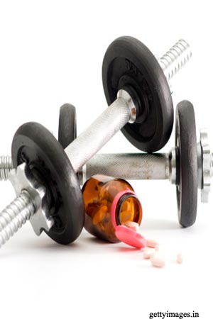 Dumbbells and weight gain pills