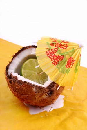 Piece of lemon placed inside coconut