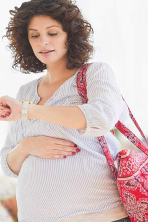 Pregnant woman travelling in comfortable clothes