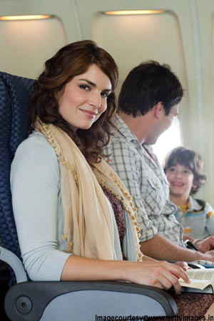 Pregnant lady travelling happily on plane
