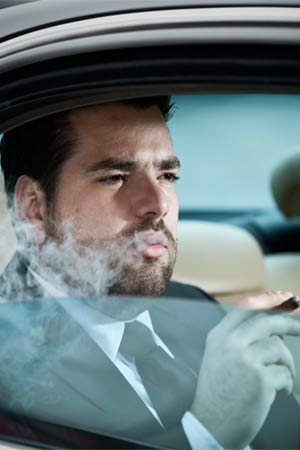 Man smoking in a car