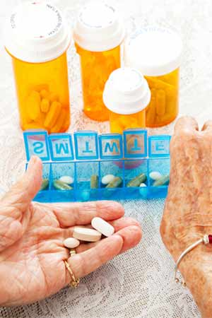 Elderly Womans Hand sorting pills