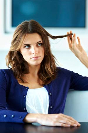 a girl worried about dull hair
