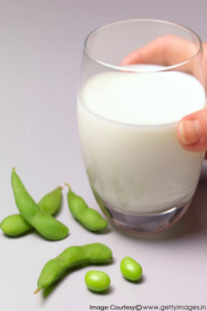 a glass of milk and soya beans
