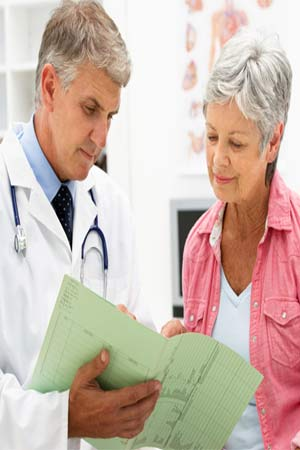 elderly woman consulting a doctor