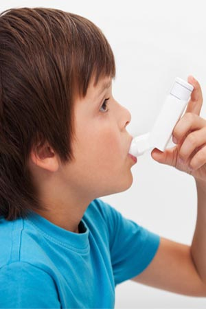 A boy using inhaler