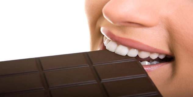 woman eating chocolate in hindi