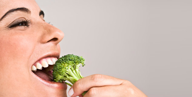 Woman eats broccoli in hindi