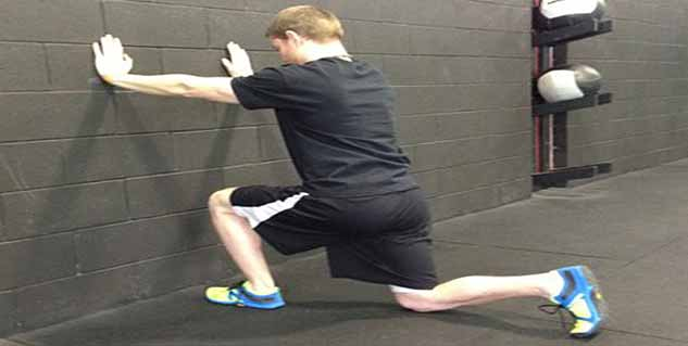 Man lunging in front of wall