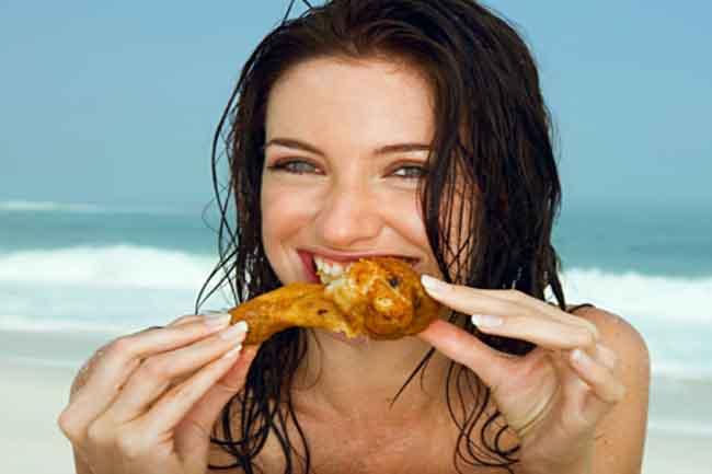 Girl eating chicken in Hindi
