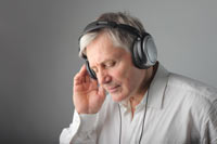 Old man listening music