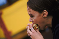 Woman having a burger