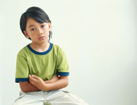 Boy sitting with arms crossed